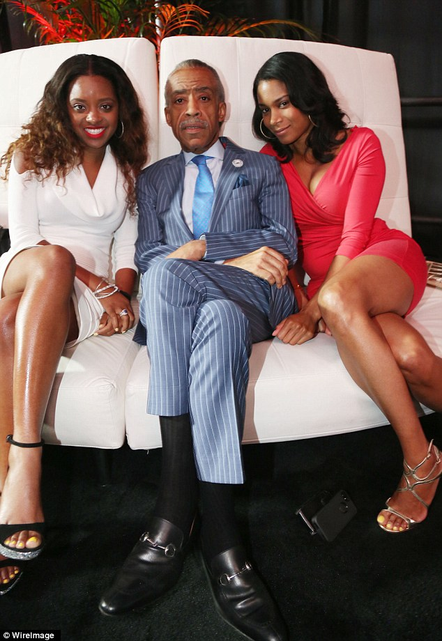 Looking sharp: Rev. Al Sharpton cosies up with Aisha McShaw (right) and a friend