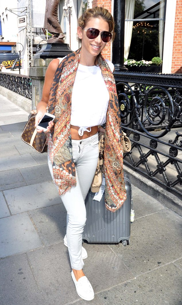 Georgia Salpa shows off her studded Christian Louboutin shoes as she arrives at the Shelbourne Hotel in Dublin on Tuesday