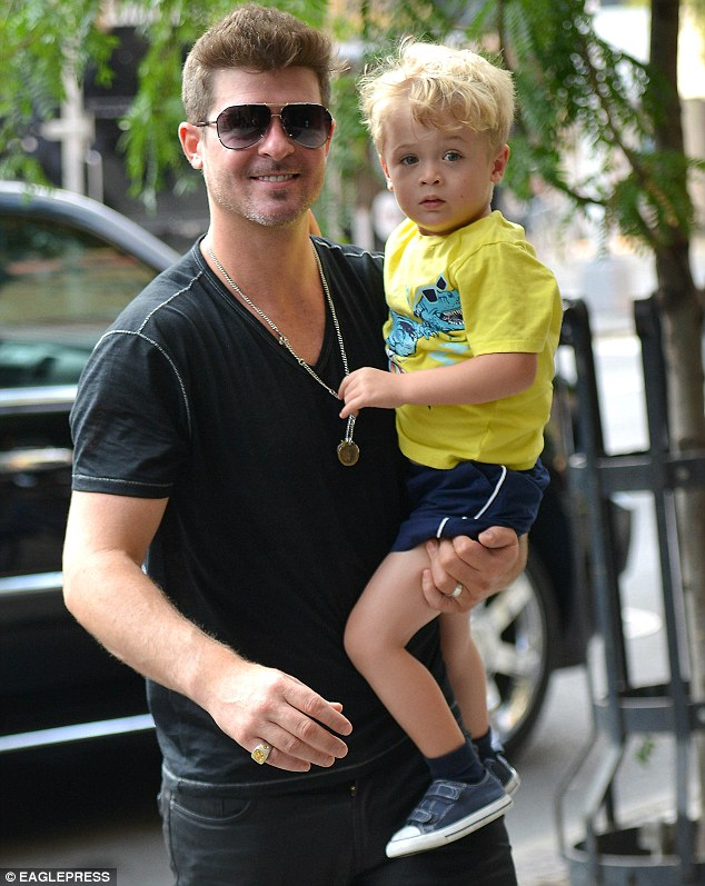 Proud pop. Blurred Lines singer Robin Thicke steps out in black tee with his son Julian in New York City