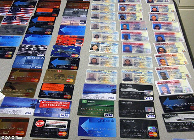 Material evidence: Police seized more than 50 credit cards and more than 20 fake or stolen driver's licenses from the couple