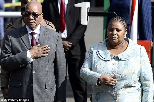 Milestone: South African President Jacob Zuma flanked by South African Defense Minister Nosiviwe Mapisa-Nqakula celebrate Mandela's birthday outside the hospital