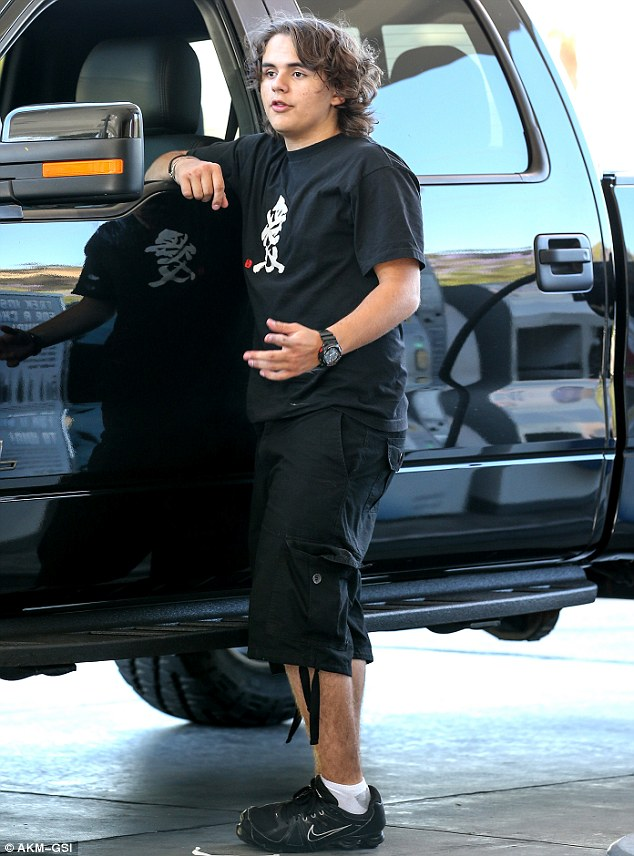 Filling up: The teenager gases up his truck in Calabasas in June
