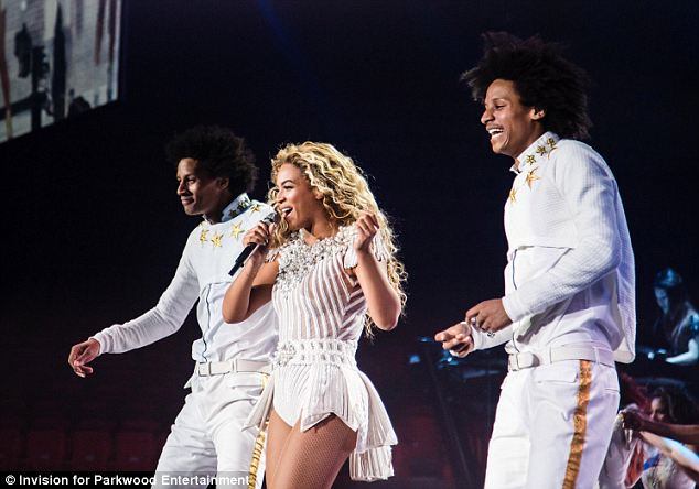 Taking in a show: Mrs Obama, Malia, and Sasha all went to see Beyonce as her 'Mrs Carter Show' hit Chicago Wednesday