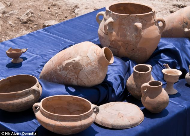 A display of some of the 600 ceramic vessels found at Khirbet Qeiyafa, alongside King David's 10th century BCE palace