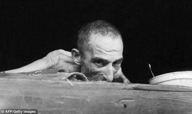 Terrible death: A prisoner dying of dysentry at the Nazi concentration camp of Buchenwald