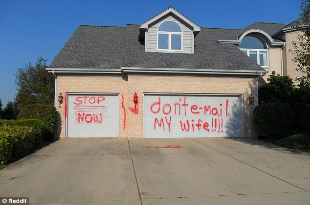 Message received: A Reddit user shared a photo of a house in Illinois with garage doors tagged with a message for a man who apparently has been making advances to his wife, which read: 'don't e-mail my wife!!!!' and 'stop now'