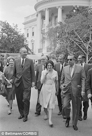 LBJ: Thomas, seen here walking at the White House with President Lyndon Johnson