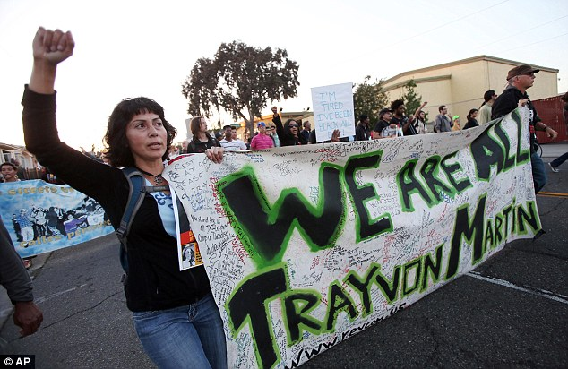 Support: People march through Oakland, California, as part of the Justice for Trayvon rally