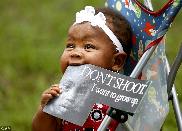 Protection: Eight-month-old Tyleigh Gould in Florida was one of many children taken to the rallies as parents voiced concern at the trial verdict