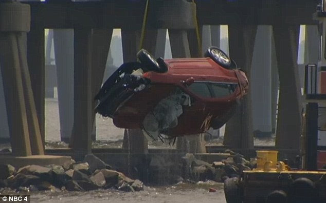 Soft landing: The woman landed in about six to eight feet of water and was able to escape the car and swim to a nearby jetty