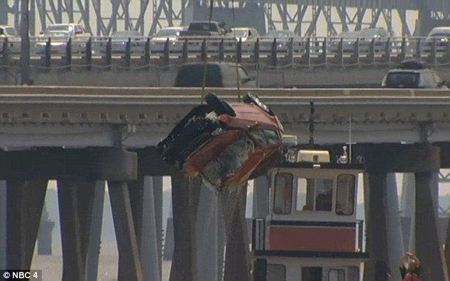 Bridge crash: A bridge crane lifted the vehicle out of the bay Saturday afternoon