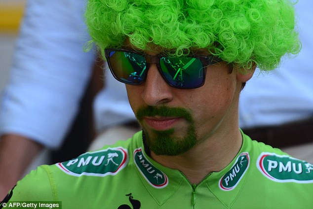 Good in green: Slovakian sprinter Peter Sagan adds a bit of green dye and a wig to celebrate his victory