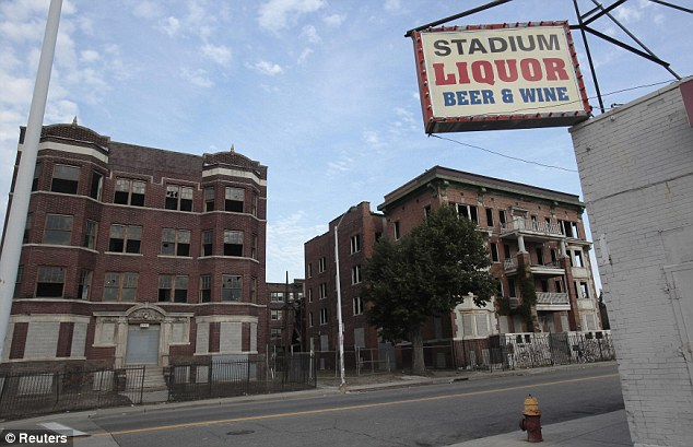 Urban decay: Two vacant and boarded up apartment buildings sit across from a liquor store near downtown Detroit, MI, a city that has become symbolic of the plight of declining inner cities in the U.S.