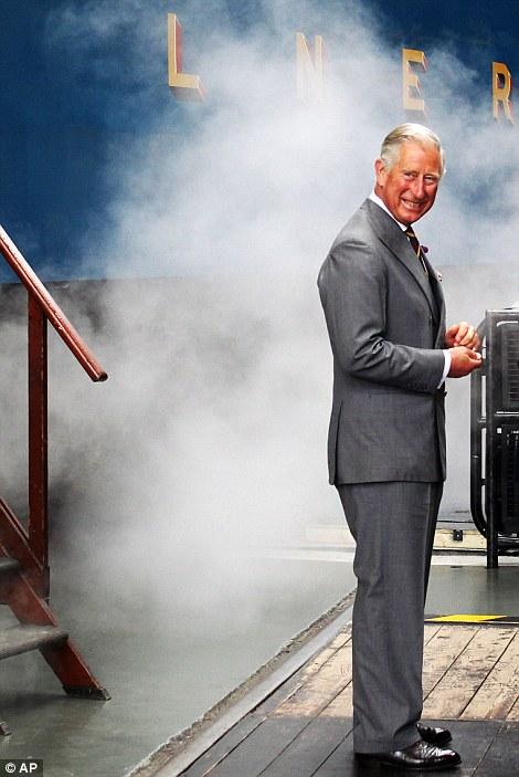 Britain's Prince Charles arrives on the Bittern steam locomotive