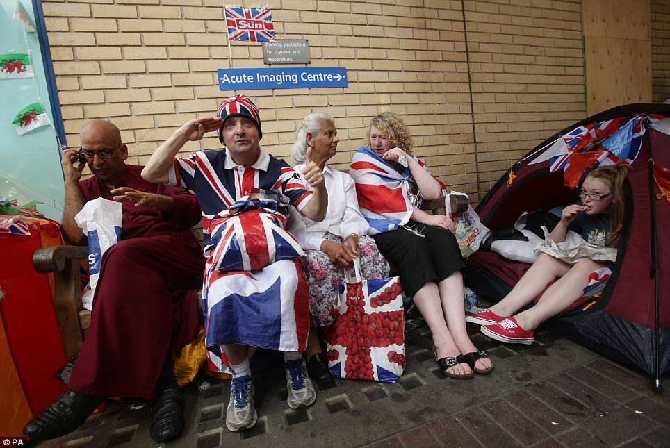 Can't wait: Passionate monarchists who have camped out for days and weeks are just hours away from the announcement of the royal birth