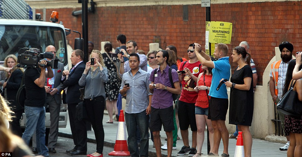 Excitement building: Members of the public gather outside St Mary's Hospital this morning as the Duchess of Cambridge goes into labour