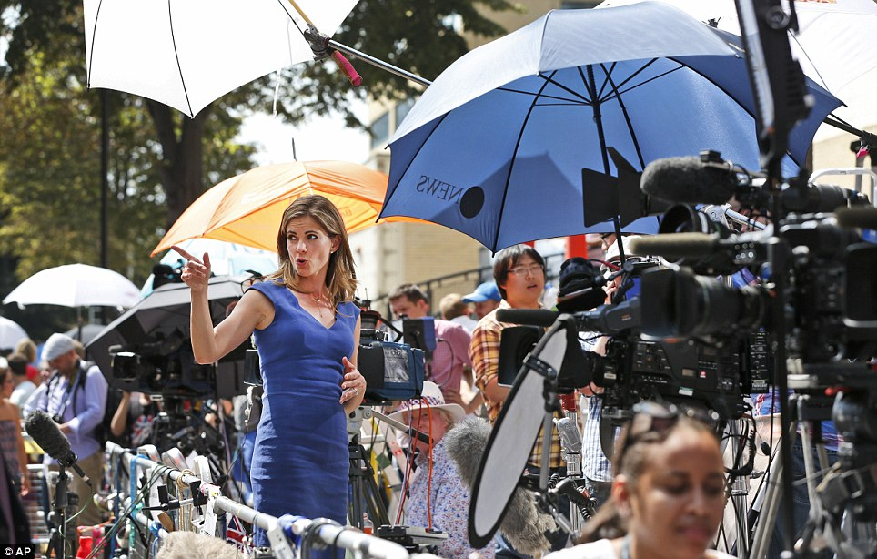 Going live: Broadcaster Natalie Morales, of NBC News, reports from outside the Lindo Wing as the world waits for news on the royal birth