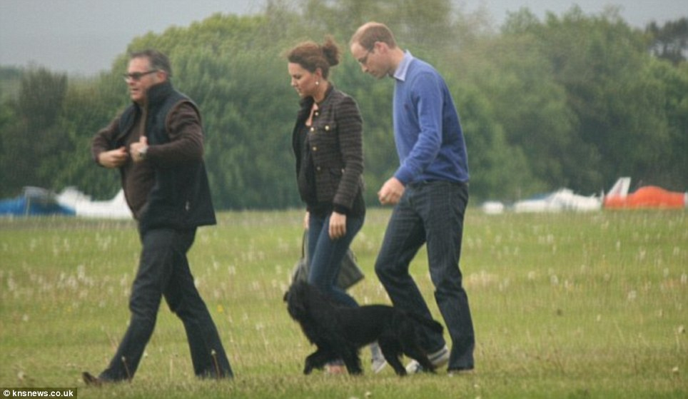 Taking it easy: The Duchess, her husband and their dog Lupo were given a lift home from Wales by friend Simon Oliphant-Hope in his helicopter on June 25