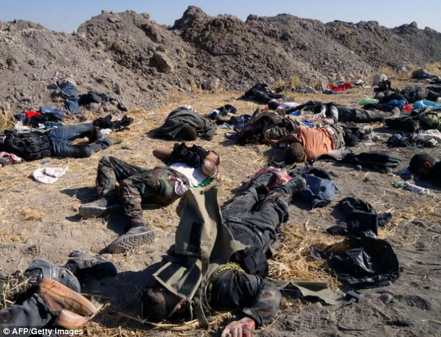 Elsewhere, bodies of rebel fighters were pictured after an ambush yesterday by President Assad's forces in Adra, near Damascus. The picture was issued by the state-run news agency Sana