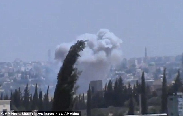 Columns of smoke billowing as a result of heavy bombing, in the countryside outside of Aleppo Syria