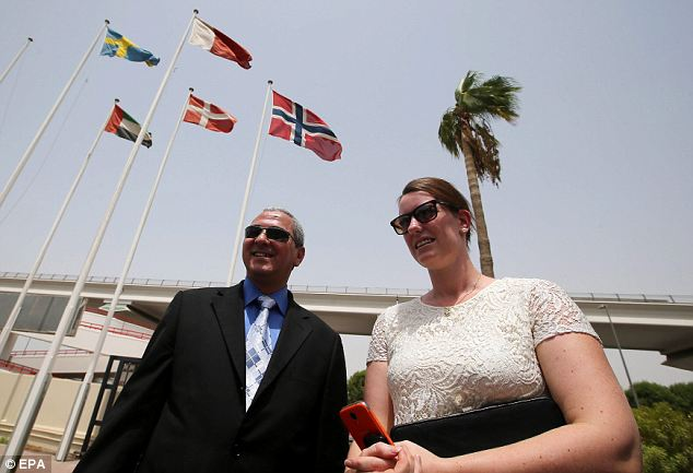 Free at last: Ms Dalelv and her lawyer Mahmoud Azab Abu Gardea arrive at the Norwegian Seamen's Center in Dubai today
