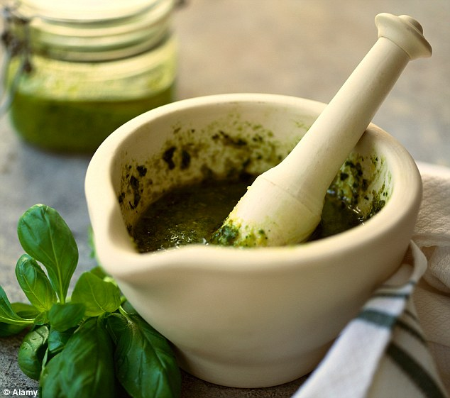 A local brand of Italian green pesto, made with basil (see stock picture), has been linked with Botox contamination after more than 50 people were hospitalised