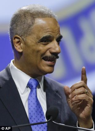 Attorney General Eric Holder delivers the keynote address at the annual NAACP convention, Tuesday, July 16, 2013, in Orlando, Fla.