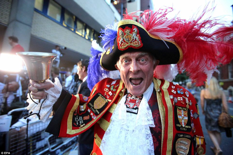 Royal frenzy: Self-proclaimed Town Crier Tony Appleton rings his bell in celebration outside St Mary's