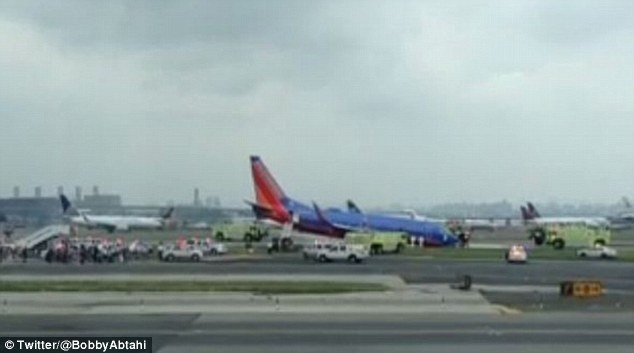 Three injuries were reported aboard the Southwest Airlines Boeing 737-700 jetliner, which was bound from Nashville, Tennessee