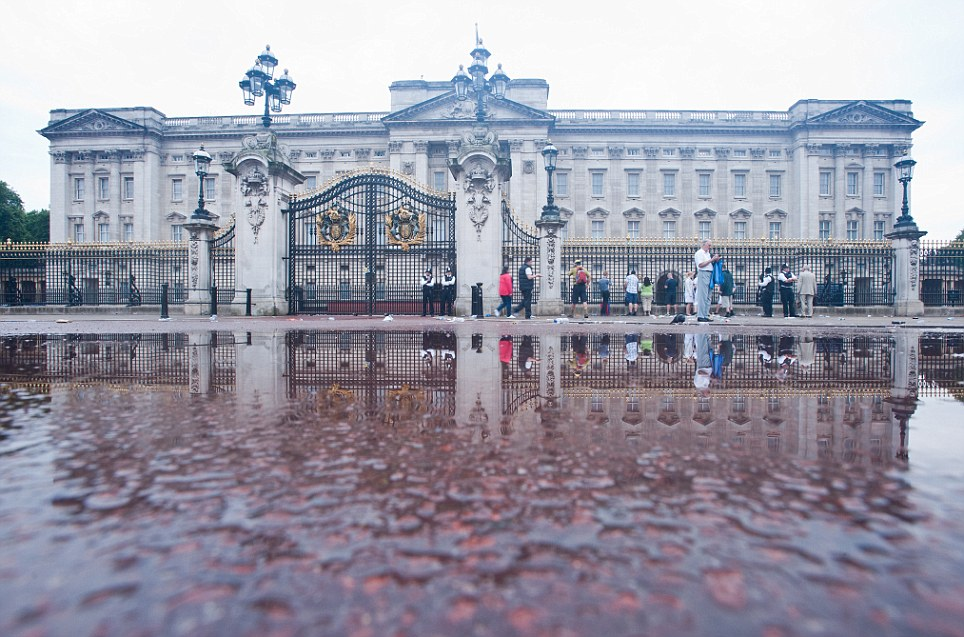 The morning after: After London was soaked by torrential rain from violent thunderstorms overnight police and a few tourists survey the scene