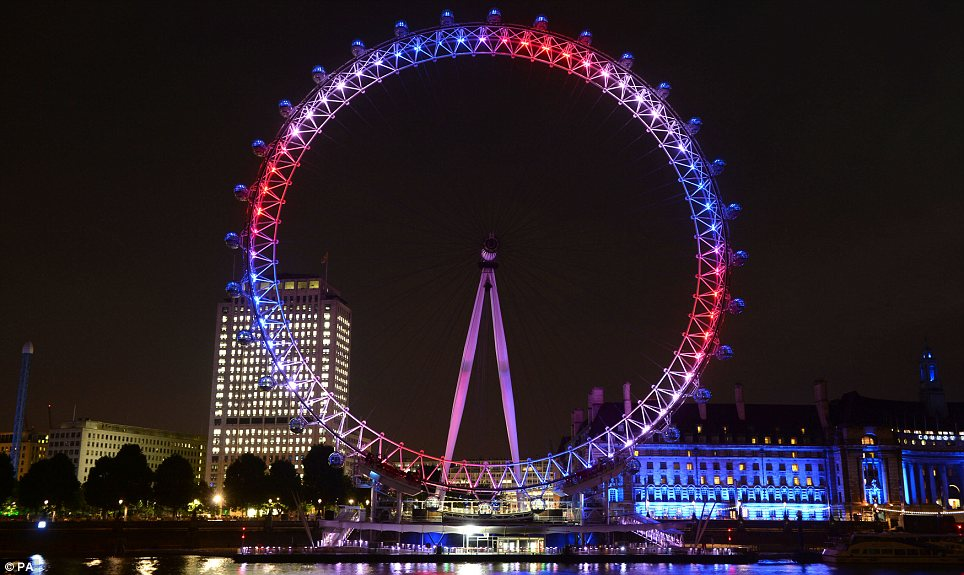Tribute: The Eye was one of many landmarks which changed colour last night after the announcement