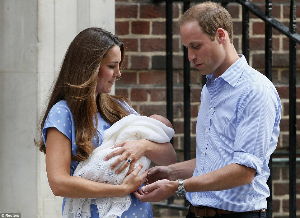 Gently does it: After Kate took the prince down the stairs, William carefully picked up their son