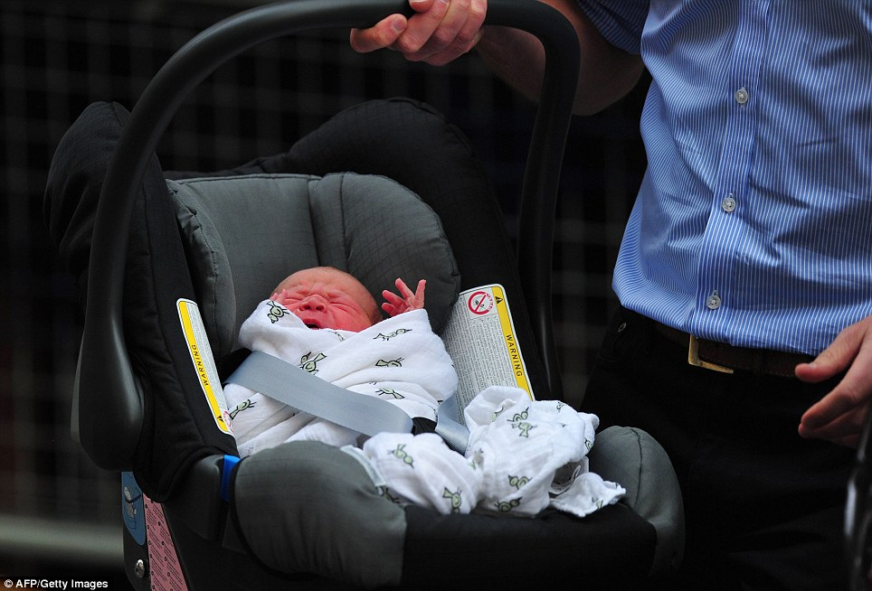 New life: The baby was crying in his car seat as his father took him to their waiting car yesterday evening