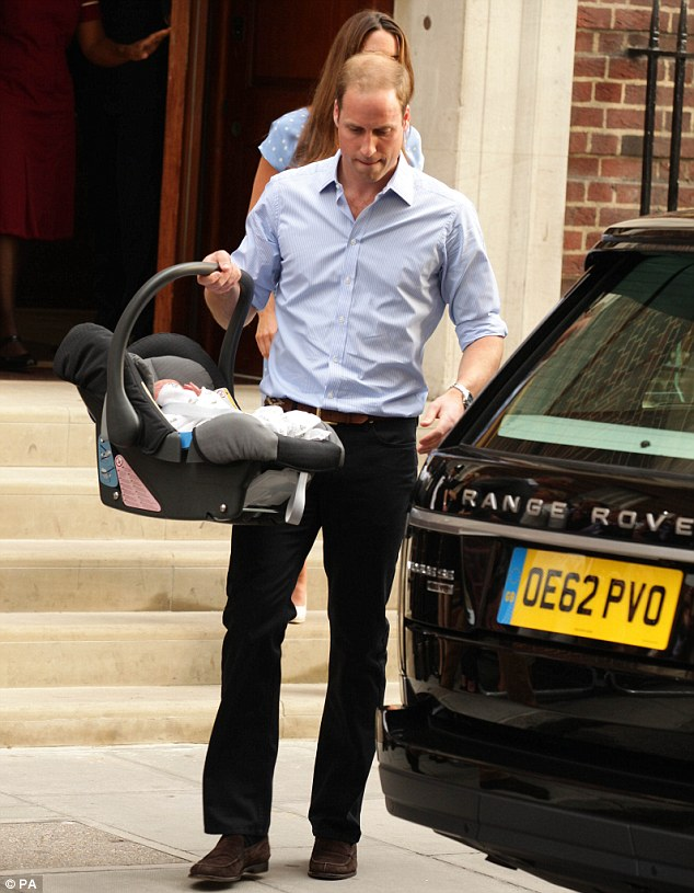 Dab hand: Brave Wills seemed undaunted that he had to fix the car seat into the Range Rover while thousands of lenses were trained upon him - and carried out the task with aplomb, leading to speculation he had practised in private beforehand
