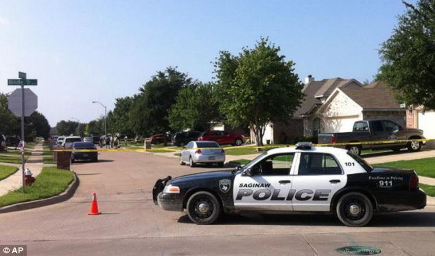 Scene: Five officers arrived at the home in Saginaw, Texas and watched as Holder pulled out a gun from his wasitband. He shot one officer, hitting him in the groin, before he was shot in the head