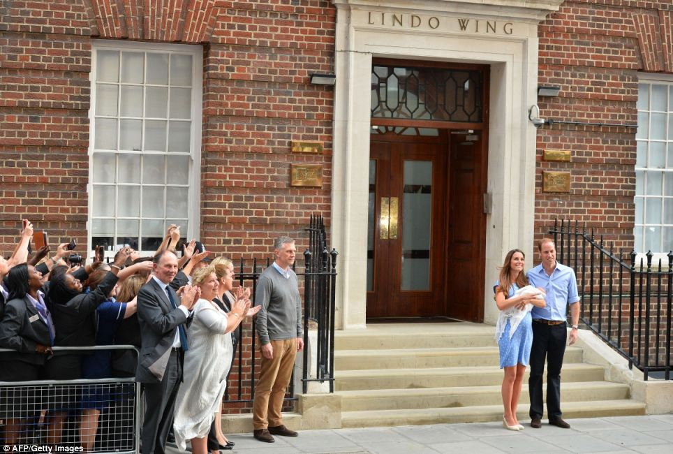 Warm welcome: The ecstatic crowd sang 'Congratulations' as the new parents stepped out of the London hospital