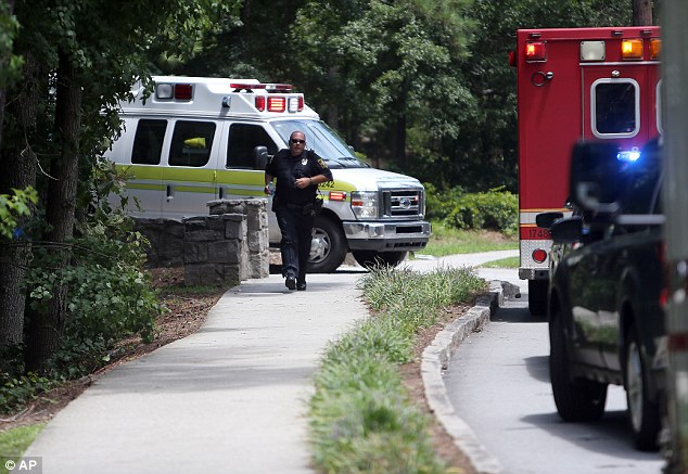 Fall: DeKalb County Fire Deputy Chief Norman Augustin said the pair had fallen down two slopes into a ravine