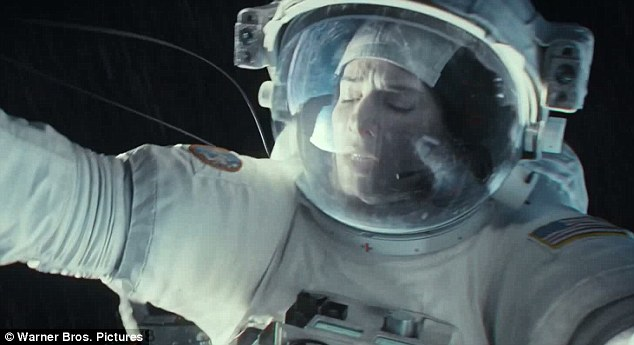 Surrounded by space: Bullock is seen panicking in the trailer as she attempts to hang on to the shuttle