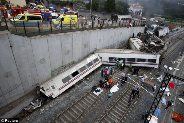 Horrifying: At least 77 people have been killed and more than 130 injured including one Briton after a packed Spanish passenger train derailed on a bend last night