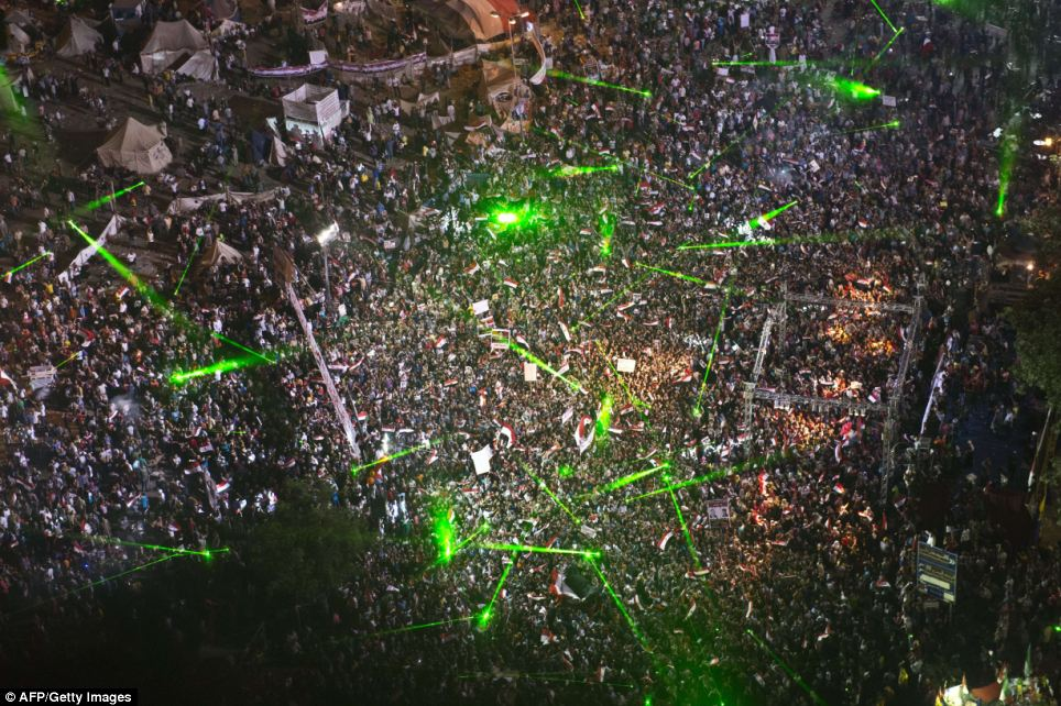 Lights: Hundreds of laser lights were shone into the sky by demonstrators in Tahrir Square who rallied to show support for the army