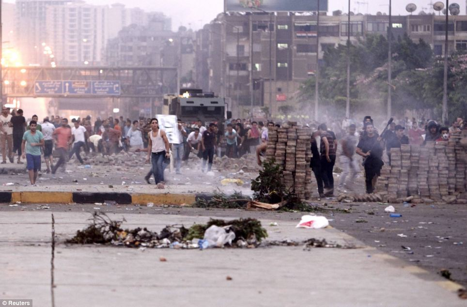 Warzone: The streets of Cairo descended into chaos as supporters of the army clashed with pro-Morsi demonstrators