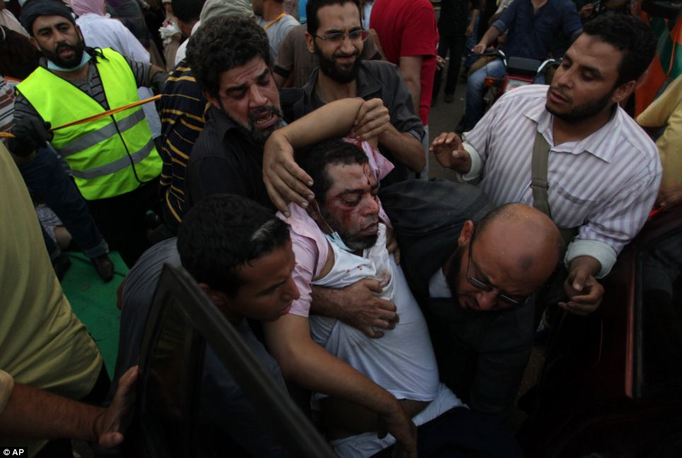Accusations: The clashes came as Morsi was accused of crimes including murder