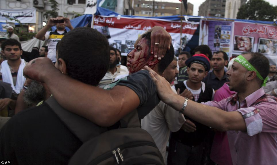 Attack: A spokesman for the Muslim Brotherhood claimed hundreds of people were injured when security forces shot at them in the early hours of this morning