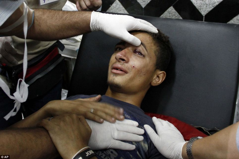 Help: A pro-Morsi supporter is treated in a field hospital following clashes between security forces and demonstrators