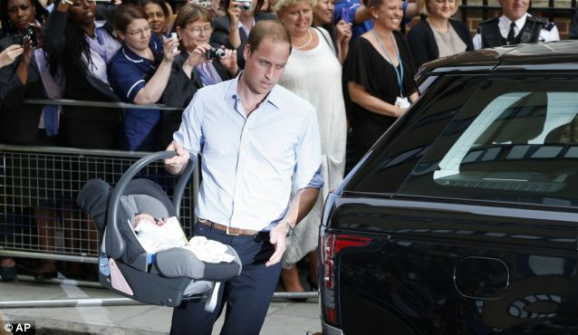 Fatherly: Prince William was seen to strap his son into the Range Rover outside the hospital on Tuesday