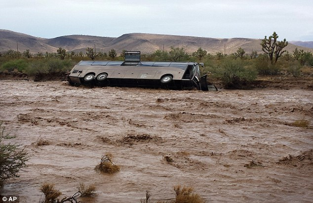 Swept Away: A flash flood in Arizona swept this tour bus 300 yards downstream before flipping it over