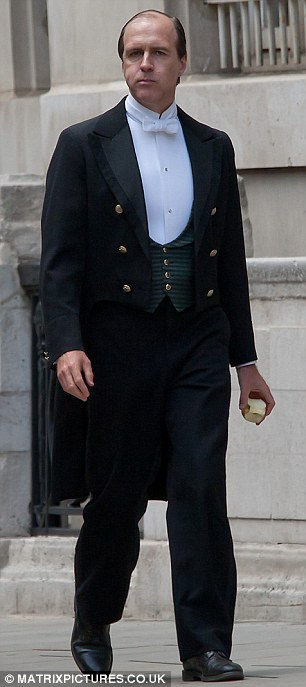 Big city life: Downton Abbey's Ed Speelers and Kevin Doyle were seen shooting scenes for the upcoming fourth series of the ITV1 period drama in central London on Sunday