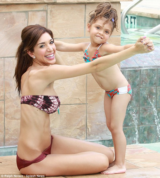 Pool day: Farrah Abraham relaxed by the pool at her Texas home with daughter Sophia on Sunday