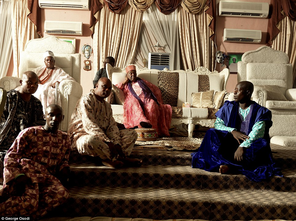Alayeluwa Oba Okunade Sijuwade, the current Ooni of Ife, relaxes in his throne room surrounded by some of his royal aides. Born in 1930, he is the grandson of the Ooni Sijuwade Adelekan Olubuse I