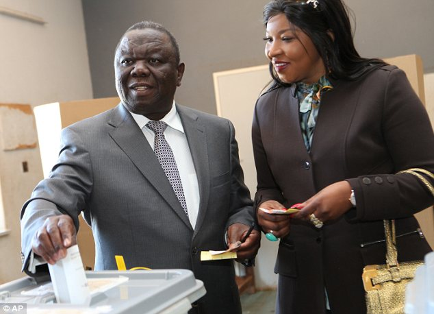 Opponent: Prime minister Morgan Tsvangirai, pictured with his wife Elizabeth, is vying to be president